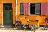 Picturesque Of Copenhagen. Old Yellow House Of Nyboder District With Bikes. Old Medieval District In poster