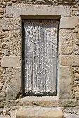 pic of macrame  - Macrame doorway curtain in an old stone house - JPG
