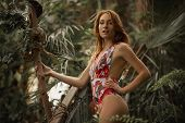 Attractive Red Woman With Python. Beautiful Ginger Girl Observe For Snake In Tropical Garden. Attrac poster