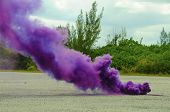 picture of unnatural  - a cloud of purple smoke rises from a smoke bomb - JPG