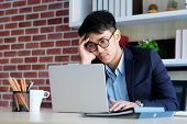 Young Asian Businessman Concentrate On Working With Laptop Computer At Office, Asian Office Man Comt poster