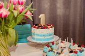 Bright Turquoise Baby Birthday Cake And Candy Bar One Year Party.interior Decoration For A Kids Chil poster
