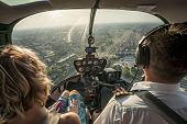 Portrait Of Beautiful Blonde Women And Pilot Enjoying Helicopter Flight. She Is Amazed By Cityscape  poster
