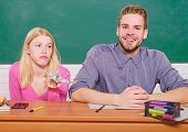 Carefree Students. Enjoying Time In College. Guy And Girl Sit Classroom. Studying In College Or Univ poster