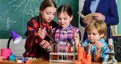 Happy Children Teacher. Back To School. Kids In Lab Coat Learning Chemistry In School Laboratory. Do poster