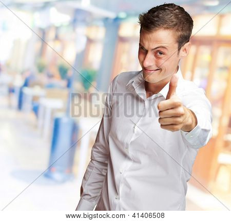 Handsome Man With Thumbs Up Sign And Winking, Outdoor