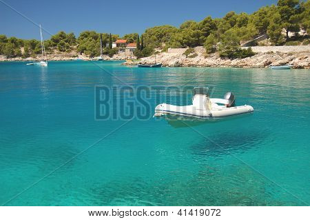 Motorboat in a quiet bay on Brac island in Croatia
