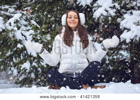 woman sitting  in winter park