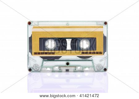 Compact Cassette Isolated On White With Blank Gold Color Label
