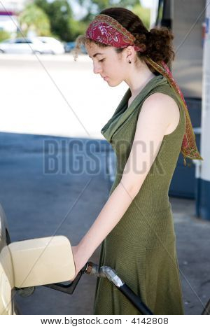 Teen Pumping Gas