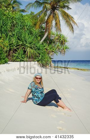 Young Woman On White Sand Beach On Maldives