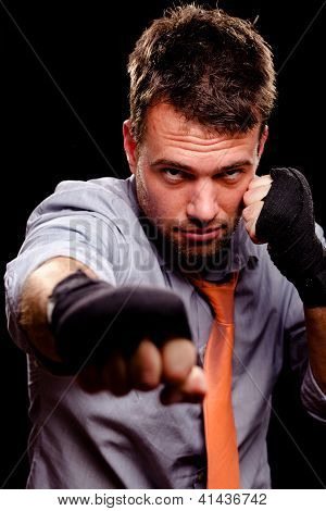 Boxing Businessman Throwing A Jab. High Contrast.