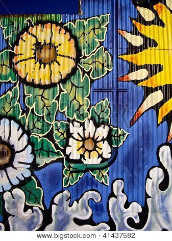 Wall Art of Flowers And A Drainpipe