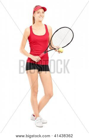 Full length portrait of a smiling female holding a tennis racket and a ball isolated on white background