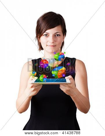 Young business woman looking at modern tablet with colourful pie charts