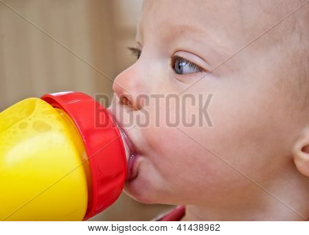 Closeup Of Toddler Drinking Milk