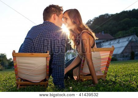 Young Couple Bonding In A Park At Sunset