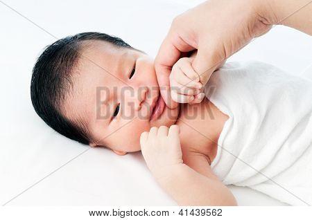 Newborn Baby Holding Hand