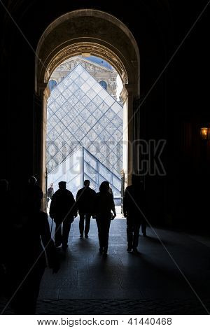 PARIS - APRIL 13. Silhouettes of Louvre visitors against Glass Pyramid, April 13, 2008, Paris, France. The Louvre is one of the world's largest museums. Author of glass pyramid is Architect I.M.Pei.