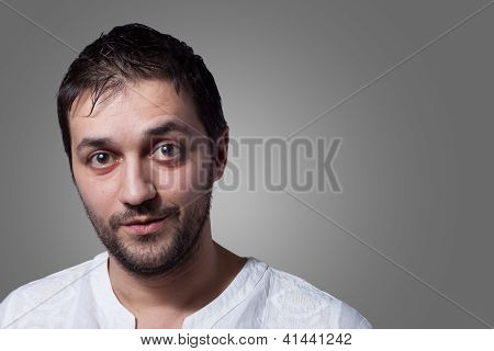 Young Man With Beard With A Little Smile