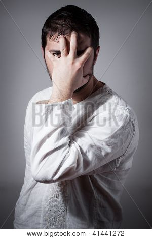 Young Man Hiding His Face With Hand