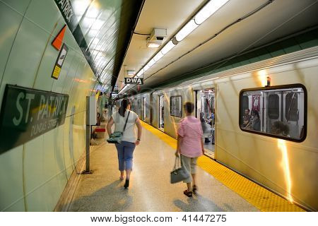 TORONTO, CANADA - JULY 3: Subway with passengers on July 3,2012 in Toronto, Canada. Operated by Government of Ontario in Great Toronto, it carries over 217,000 passengers weekday and 57 M annually.