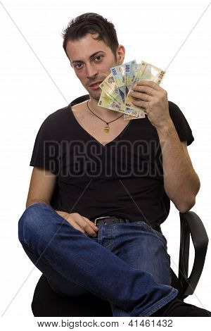 Man Sit On Chair And Hold Money