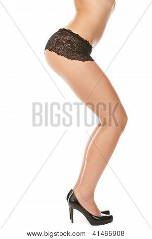 Buttocks of young woman over isolated white