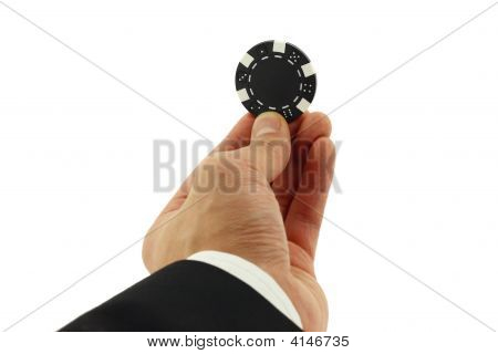 Casino Chip In Hand Isolated On White