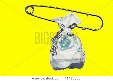 Bag with dollars and safety pin