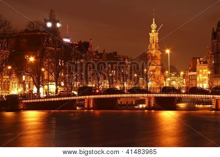 Amsterdam by night with the Munt tower in the Netherlands