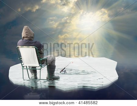 An fisherman floating on the iceberg. Spring ice thaw concept.
