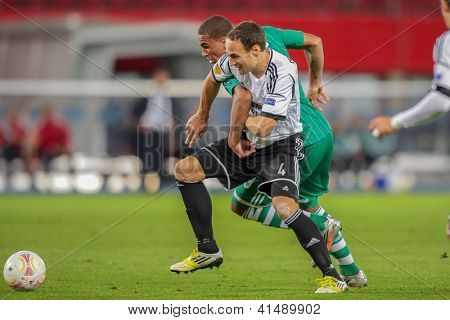 VIENNA,  AUSTRIA - SEPTEMBER 20 Terence Boyd (#9 Rapid) and Tore Reginiussen (#4 Trondheim) fight for the ball during the Europa League soccer game on September 20, 2012 in Vienna, Austria.