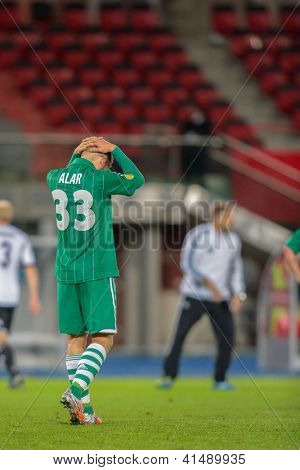 VIENNA,  AUSTRIA - SEPTEMBER 20 Deni Alar (#33 Rapid) leaves the field after the Europa League soccer game on September 20, 2012 in Vienna, Austria.