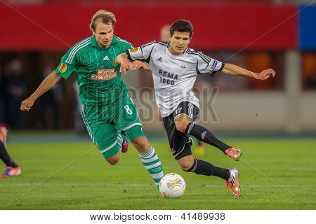 VIENNA,  AUSTRIA - SEPTEMBER 20 Markus Heikkinen (#8 Rapid) and Tarik Elyounoussi (#17 Trondheim) fight for the ball during the Europa League soccer game on September 20, 2012 in Vienna, Austria.