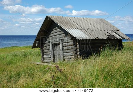 Old Wooden Shed On The Lake Bank