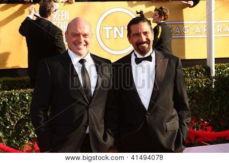 LOS ANGELES - JAN 27:  Dean Norris, Steven Michael Quezada arrive at the 2013 Screen Actor's Guild Awards at the Shrine Auditorium on January 27, 2013 in Los Angeles, CA