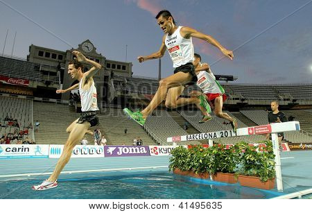 BARCELONA - JULY, 22: Alex Genest of Canada(L) and Jimenez Pentinel(R) of Spain during 3000m steeplechase Event of Barcelona meeting at the Olympic Stadium on July 22, 2011 in Barcelona, Spain