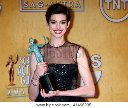 LOS ANGELES - JAN 27:  Anne Hathaway  in the press room at the 2013 Screen Actor's Guild Awards at the Shrine Auditorium on January 27, 2013 in Los Angeles, CA