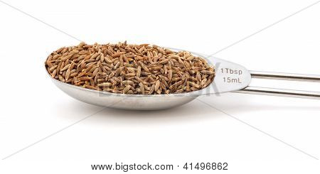 Cumin Seeds Measured In A Metal Tablespoon