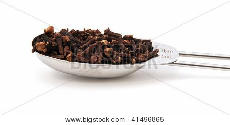 Whole Cloves Measured In A Metal Tablespoon