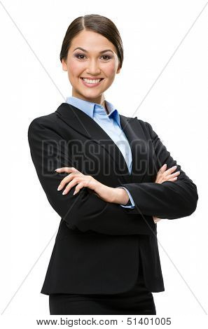 Half-length portrait of female executive with hands crossed, isolated on white. Concept of leadership and success