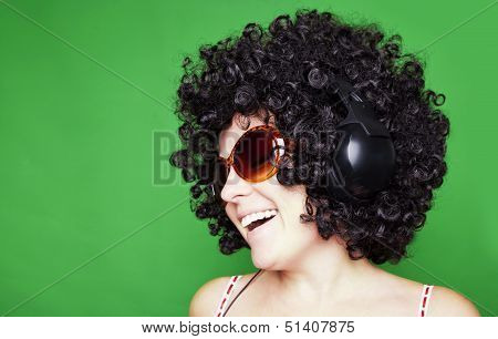 Smiling Woman With Afro Hair Listen To Music With Headphones