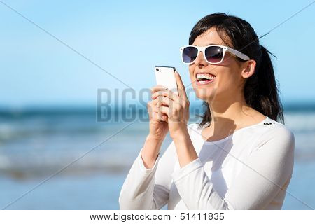 Woman Typing Message On Cell Phone
