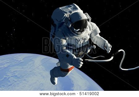 Astronaut in space against a starry sky..