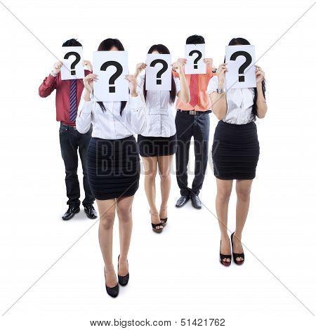 Business Team Hiding Behind Question Mark Symbol