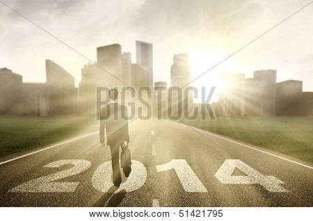 Businessman Walking In The Road