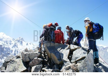 Group Of Climbers On The Top Of Mountain