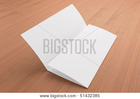 Blank Tri Fold Brochure On Wooden Background