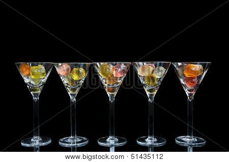 Cocktail glasses with colorful fruit gelatine